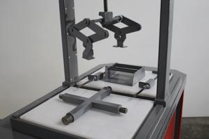 Фото механизма для сборки и разборки аккумуляторов